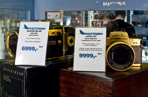 Hasselblad and Leica film cameras in gold