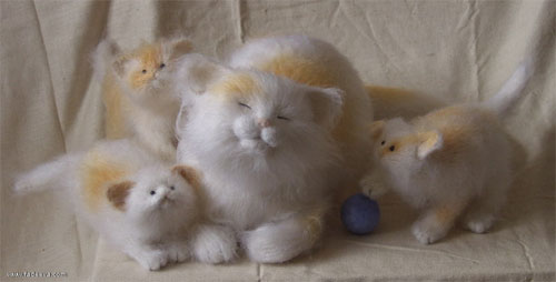Happy cat with her kittens