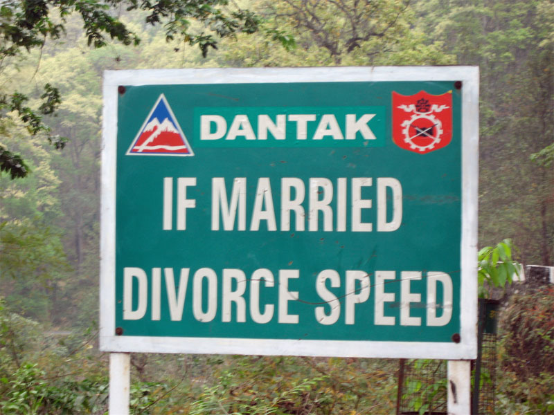 road sign: if married, divorce speed