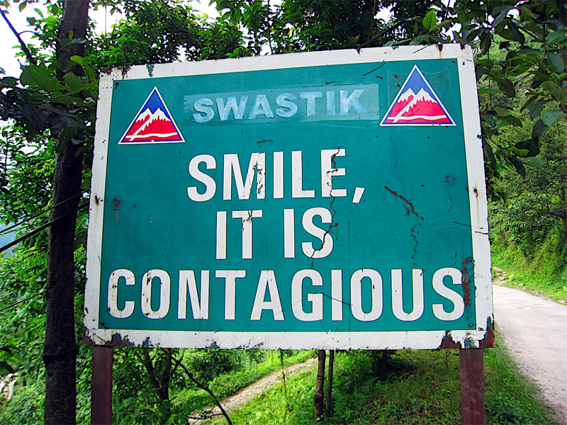 road sign: smile, it is contagious