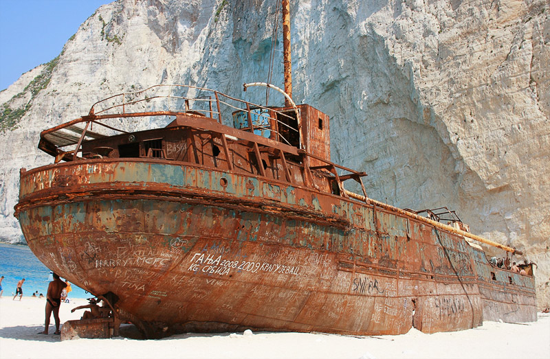 Writings in English and Serbian on the wrecked ship