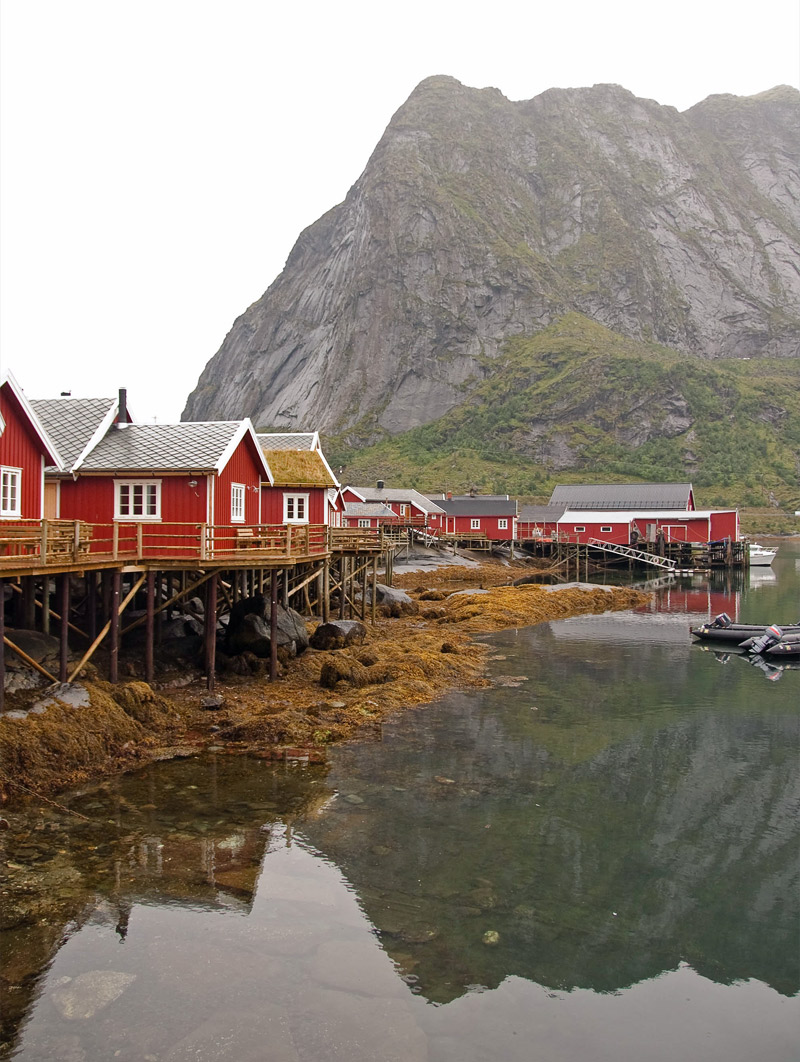 Reine boathouses in cloudy weather
