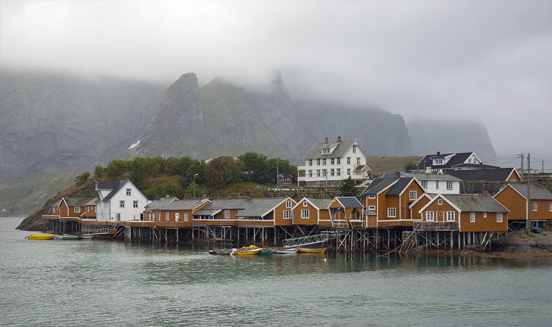 The top of Reinebringen mountain is shrouded in clouds