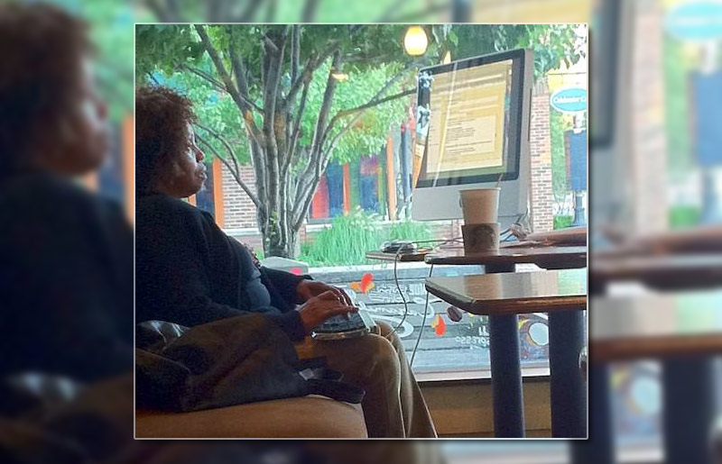4. A woman using her 24 inch iMac in the Starbucks café, 2011. Photo by Dave Linabury
