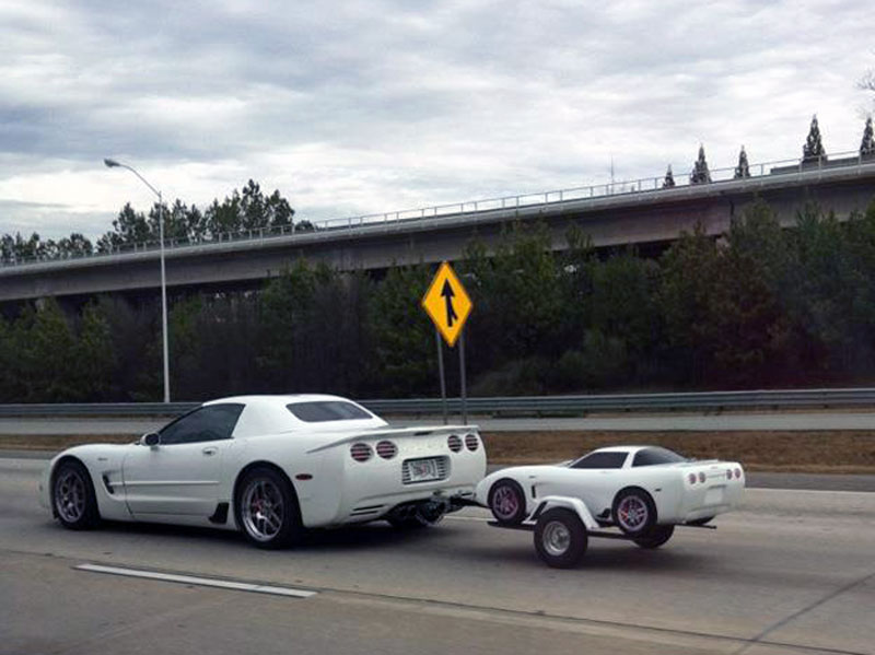 2. White Corvette is towing the baby Corvette