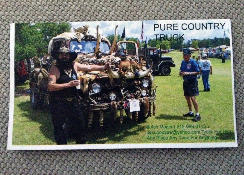 Butch Moger's card with the Pure Country hunting truck pictured on it