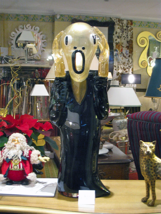 2. The Scream man statuette in the window of the gift shop