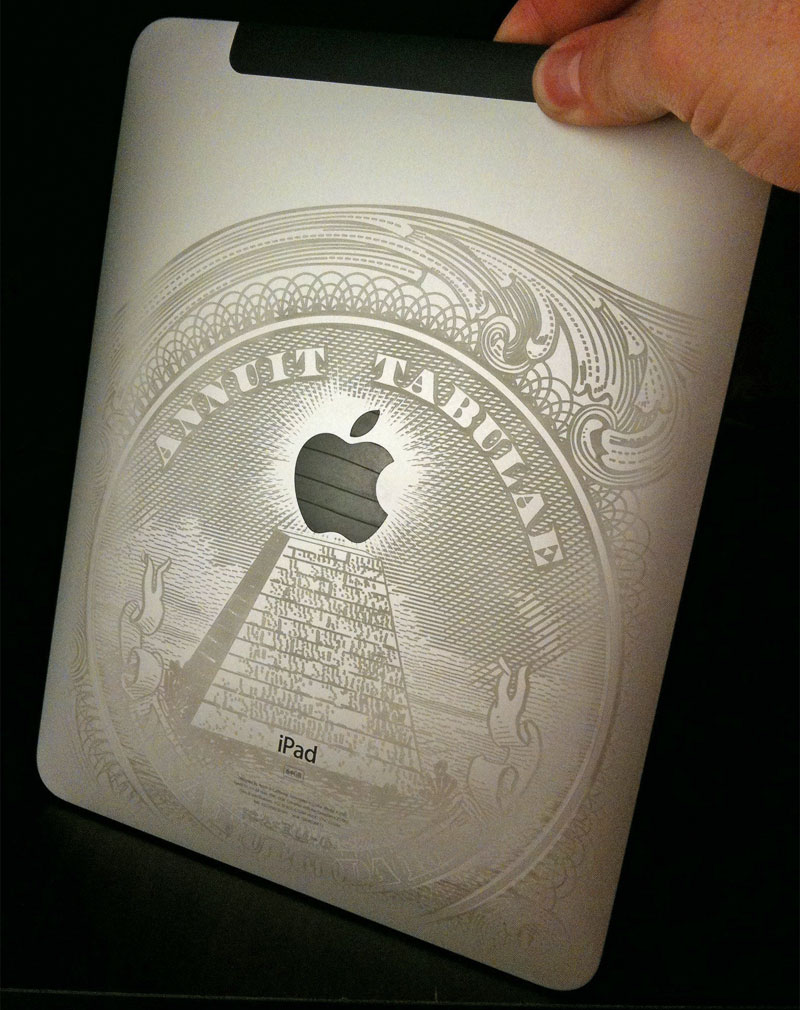 Justin Ross holding his iPad with the Dollar bill engraving