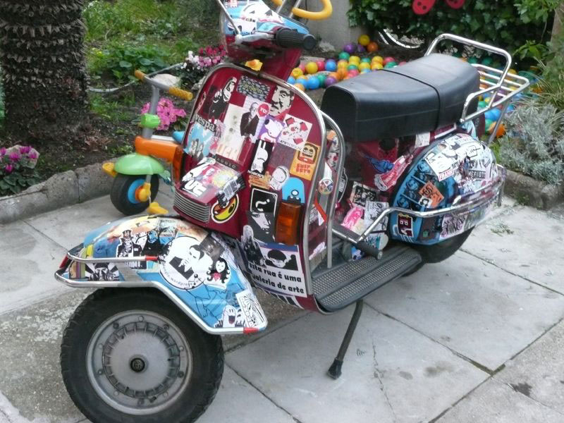 2. Scooter with stickers. A profusely decorated Vespa