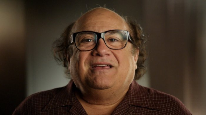Danny DeVito was working as a barber.