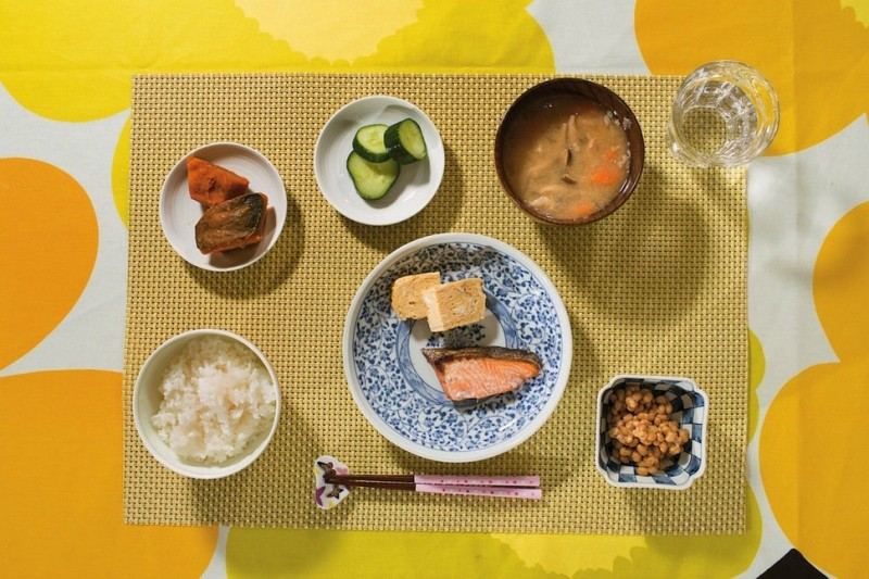 soybean natto, white rice, miso soup, squash in soy sauce, pickles, grilled salmon and scrambled eggs