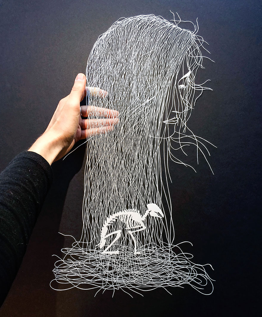 Intricate hand-cut paper art by Maude White