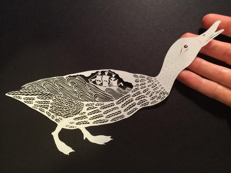Intricate hand-cut paper art by Maude White